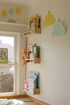 I've loved this idea for a long time, but no IKEA in town... anyone want to pick up a few of these for me?  :-)  Ikea BEKVAM spice rack + paint = children's bookshelf