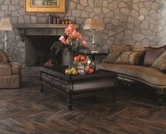 Wood look tile set in herringbone pattern. The Interceramic Forestland collection is perfect for decorating a space with a natural, classic appearance. These wood look tile floors are perfect for creating the warm, comfortable appearance of hardwood in a space, with added durability and eco-friendly design.