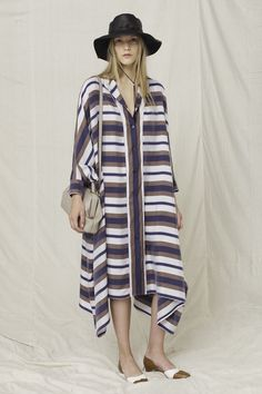 Tunic Shirt Dress with tri-color stripping. This ensemble is accompanied by the streetwear popular bucket hat, but as the row likes to do. The bucket hat is black leather. A classy combination to go with the silk dress for this resort season. #TheRow #RTW #NYFW #Resort2013