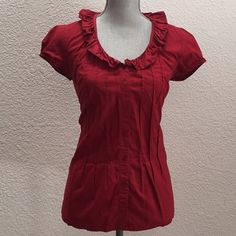Red ruffled fitted blouse This little red ruffled number has a nice tapered and fitted body. The ruffles and pleats are super cute and flirty. Merona Tops Button Down Shirts