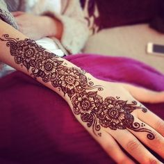 Pretty Henna! I have always wanted to do henna for my wedding, but I don't want it to show....maybe on my leg?...or on my foot/ankle?
