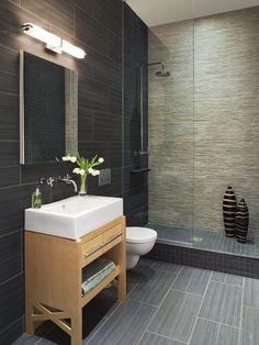 More masculine floor tile for bathroom. Upside: bigger tiles = less painstaking cuts!
