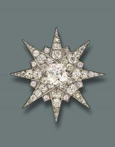 A FINE DIAMOND BROOCH, BY CART