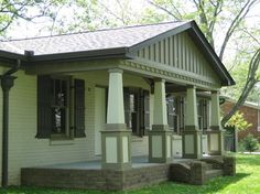 "Exterior Renovation In Franklin, TN  Front porch addition to a plain brick ranch to attain a craftsman style appearance. Board & Batton gables, custom craftsman columns, ""old style"" brick band and many other craftsman details were added to totally renovate this 60's style ranch home."