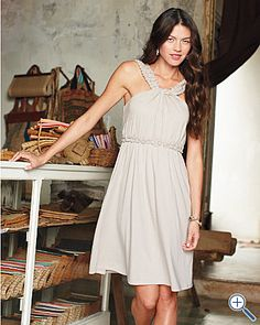 Gorgeous Grecian-style dress. Beautiful detail around the neck and waist. $128