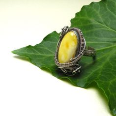 Silver wire wrapped ring, yellow amber, vintage style, wirework, metalwork. $150.00, via Etsy.