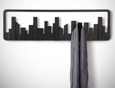"A playful nod to the architects and builders of our time, the Skyline wall-mount multi-hook by Umbra was designed to look like a ""window on the wall"" to the cityscape beyond."