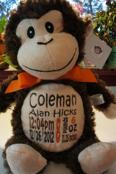 Baby Cubby Huggles the Monkey w/ child's personalized baby info. Wonderful keepsake to have.