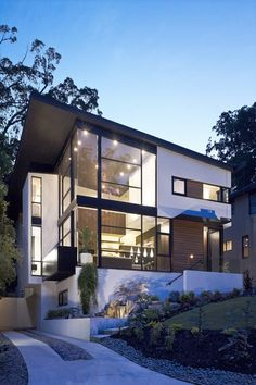 I love this house design! The one thing I don't like is all the windows being so huge