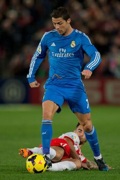 Cristiano Ronaldo competes for the ball with Suso during the La Liga match between UD Almeria and Real Madrid CF at Estadio de Los Juegos Mediterráneos on November 23, 2013 in Almería, Spain.
