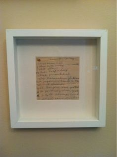 Frame old family recipes.  This one was written by my grandmother and was added to the photo wall arrangement in kitchen!