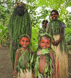 What a sweet family. Look at the pride in the parents and the sweetness in the little ones' eyes.  I love this photo! ...Vanuatu