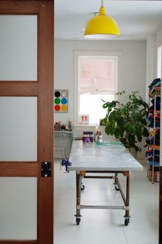 Utility Room: Via apartment therapy; door, light, table in utility rm