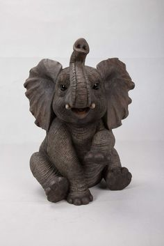 Elephant Baby Sitting Trunk Up