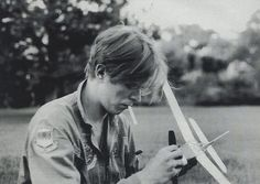 """This is from one of my favorite online photo albums, """"Pictures of David Bowie Doing Normal Stuff"""" on Flavorwire. Ziggy Stardust just enjoying his model aircraft."""