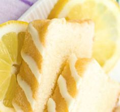 This delicious cake is made in one tin then cut into slices. It has a lemon syrup poured over the hot cake, then a lemon icing drizzled over the cooled cake. The crystallised violets make it a very pretty cake to serve to your favourite friends! Aga Recipes, Snack Recipes, Dessert Recipes, Snacks, Violets, Deserts, Chips, Lemon, Cooking