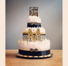 Black gold and white three tier diaper cake by JennyKnickDesigns