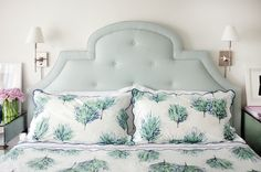 Bedroom by Alyssa Kapito Interiors. Matouk linens and a mint headboard make for a beautiful bedscape