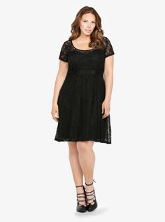 Sheer floral lace overlays a soft knit LBD that's equal parts sexy and sweet. Seam detailing on the bodice and waist creates flattering lines. A matching sash contours the fabulous feminine silhouette. Fully lined.