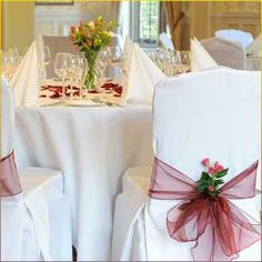 white chair covers with purple tulle/pink flowers? Chair Sashes, Chair Backs, Wedding Events, Wedding Reception, Weddings, White Chair Covers, Wedding Decorations, Table Decorations, Wedding Chairs