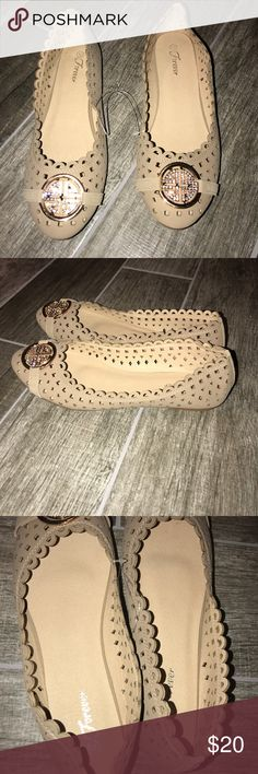 """Forever Perforated Size 10 Nude Tan Flats Perforated faux leather flats. Never worn! Size 10. I found them in the bottom of my shoe box so the left shoe is a little smashed but you can't tell when you're wearing them. The nude color means you can wear them with just about any outfit. Brand is """"Forever."""" Shoes Flats & Loafers"""