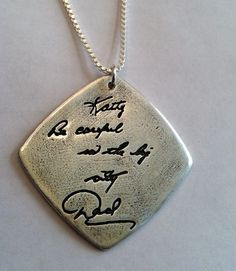I am totally doing this ... I have a note my Dad wrote me not long before he died.    Memorial Jewelry Your Actual Loved Ones Writing Silver Pendant - Doublesided. $155.00, via Etsy.