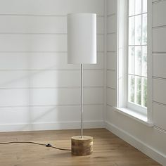 Tribeca Floor Lamp | Crate and Barrel I love this lamp as the floor lamp to go near the window/porch door at the corner of the new sectional.  Wood base is cool; shade casts a nice warm light (saw in showroom).