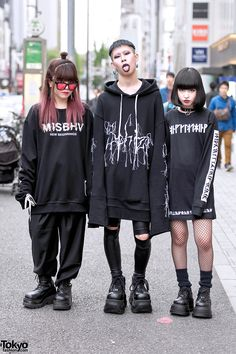 Kasumi (20), Cham (19), and Baek (17) in monochrome fashion on the street in Harajuku. Kasumi is wearing a MISBHV sweatshirt from Never Mind the XU with pants and boots also from XU. Cham is wearing a Sub-Age oversized hoodie with ripped patent leather pa