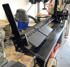 This bench-top box/pan brake can bend sheet metal into various shapes. It mounts to a workbench. It can accept up to four foot wide stock and bend 135 degrees. With the various width teeth, they can be adjusted to fit the width of the bend needed within minutes with one wrench. The clamping thickness can be adjusted from 0 to about 0.25 inches, but I would be extremely lucky to bend something that thick. The throat can open to over four inches. This brake was built from scrap I received…