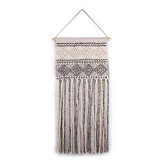 This Hand-Woven Wall Hanging brings a warm and inviting look to your home décor. In tonal colors, this lightweight, hand-woven piece adds texture and craftsmanship to the room.