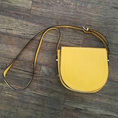 Mustard cross body bag Only used once. Super clean. Looks brand new. Has a tiny tear which isn't visible when worn in the inside by the fold as noted in last picture. Bags Crossbody Bags