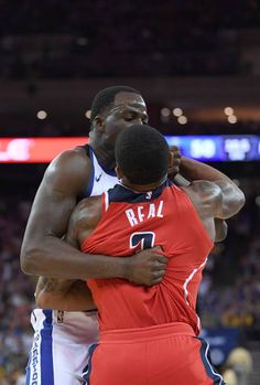 Draymond Green of the Golden State Warriors and Bradley Beal of the Washington Wizards gets tangled up in a fight during the second quarter of their...