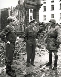 Bradley, Ike, & Patton in a secured Bastogne, January 1944  This happens to be one of my favorite photos. One, Ike is a BAMF for not blousing his boots. My kind of general doesn't blouse his boots unless he's gone to jump school. Ike in his simple uniform standing in the mud says just about everything…he cared about his troops. Two, I am pretty sure Patton is wearing Hunter rain boots. Mr. Fashionista!