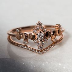 Our impressive moissanite engagement ring set, from Camellia Jewelry, will take her breath away. Custom handcrafted in the finest detail, this unique flower engagement ring features a round cut moissanite stone beautifully set in a solid rose gold flo Rose Gold Engagement Ring, Vintage Engagement Rings, Diamond Wedding Bands, Morganite Engagement, Morganite Ring, Witch Rings, White Opal Ring, Ring Set, Bridal Rings