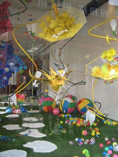 Fred Butler the talented props and accessory designer has been given the Orchard St windows which she has filled with a wonderland made from household objects while the Oxford St windows have a wonderful vibrant street market feel.
