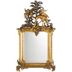 An important and rare German silver- and gilt-wood Rococo mirror, probably Potsdam, in the manner of Johann Michael Hoppenhaupt (1709-1769), after designs by his master Johann August Nahl (1710-1781). The ornamental vocabulary of this looking glas, in particular the characteristic motif of the grape-picking crane and the palmtree, can be found on the wall panelling of Frederic the Great's palaces Sansscouci, the Stadtschloss, both in Potsdam, as well as in the palace of Breslau.