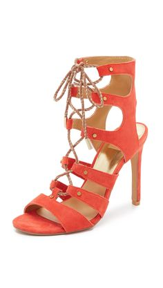 Dolce Vita Women's Howie Gladiator Sandal, Red/Orange, 9 M US. High-heeled gladiator sandal featuring two-tone ghillie laces and polished hardware.