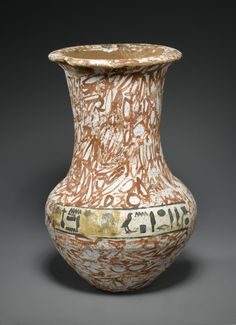 Funerary Vessel of the Wab-priest of Amon, Nefer-her, Painted to Imitate Stone, ca. 1479-1279 B.C.E. Pottery, painted, 8 1/4 x Diam. 4 7/16 in. (21 x 11.2 cm),Thebes, Egypt.