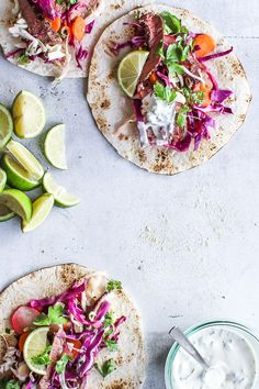Easy and delicious Mexican tacos with cabbage salad, spicy beef and jalapano dressing. Gather friends or family, server these Mexican homemade tacos and pour delicious wine, drinks or cold coronas in the glasses. Click here and grab the recipe for these healthy tacos >>