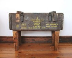 Previously carrying night warfare equipment to help locate the enemy, this solid wooden ammo box, with its heavy rope handles on both ends & solid locking mechanisms once stored 6 x 81mm Illuminating mortar bombs.  Now with its tapered wooden legs, it is geared up to function as a side table and can store any of your utilities