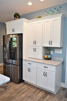 Bailey's Cabinets, Dura Supreme Cabinetry, Maple, White finish, Highland door style Maple Cabinets, White Cabinets, Kitchen Cabinetry, Baileys, Supreme, Kitchens, Laundry, Home Decor, Style