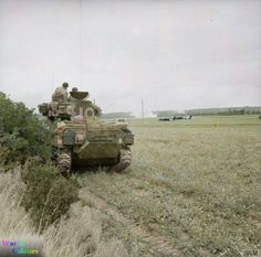 'Balaclava', a Sherman M4A2 tank of Commanding Officer, Lt Col Harrap of Regimental HQ, 13th/18th Royal Hussars, 27th Armoured Brigade engaging enemy positions using crashed Horsa gliders as cover near one of the landing grounds during a counter-attack at Bénouville near Ranville, Calvados. 10 June 1944.