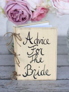 Instead of a guest book...guests just write in their own advice and sign. I would put bride  groom though.
