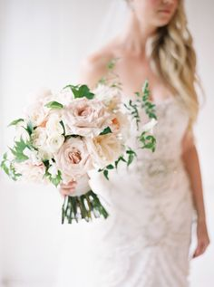 Classic blush rose bouquet: http://www.stylemepretty.com/canada-weddings/ontario/niagara-on-the-lake-ontario/2016/05/20/summer-vineyard-wedding/ | Photography: When He Found Her