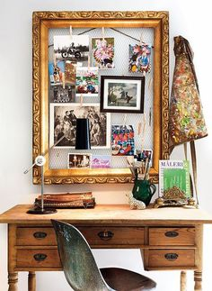Love the use of rustic chicken wire with an elegant gold frame, clothes pins, retro 60's chair and vintage desk.
