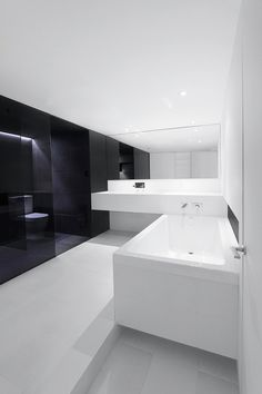 Black and white bathroom in Montreal by Anne Sophie Goneau _