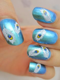 9 Best Feather Nail Art Designs : Free hand painted peacock feather nail art: Free hand painted peacock feather nail artIf you like the free hand painting way for your nail arts then try creating this sweet pattern of peacock feathers on to the nails. It will look really good.