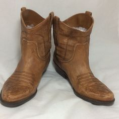 "Hand Distressed Tan Leather Ankle Boots SZ 8-1/2 Custom Distressed Tan Leather Ankle Boots SZ 8-1/2. Made in China by Franco Sarto these pull on style ankle boots have a rubber bottom, wide 1-3/4"" heel. The shaft is approx 7"" high. The color is a dark tan. I have hand distressed the leather. They were gently pre-worn. The decorative buckle is brass colored. They are lined in faux suede. The outside is REAL LEATHER. I like them much more now so I will happily keep them if they don't sell I…"