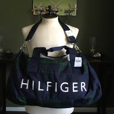 TOMMY HILFIGER DUFFLE BAG Brand new Tommy Hilfiger duffle bag! It is really really nice it m'sgreen and navy carry strap and handle strap! Great for a guy or a girl. m Tommy Hilfiger Bags