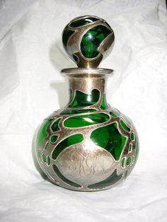 Google Image Result for http://i00.i.aliimg.com/photo/108479619/Green_Glass_Silver_Overlay_PERFUME_BOTTLE.jpg